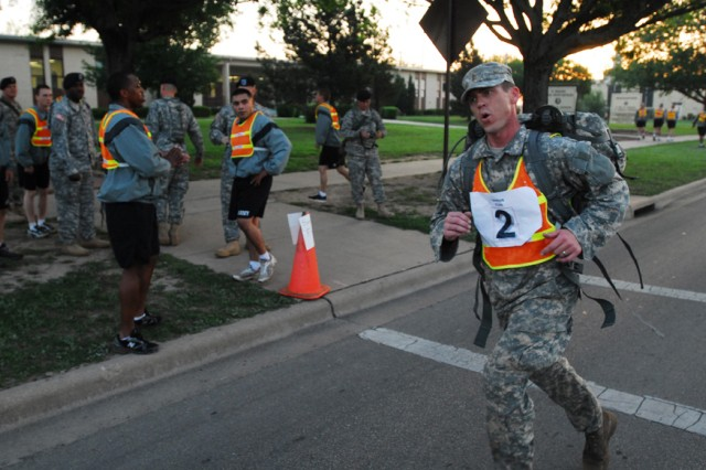 FORT HOOD, Texas-2nd Lt. Mike Ezell, a Wichita Falls, Texas native and a platoon leader with 2nd Special Troops Battalion, 2nd Brigade Combat Team, 1st Cavalry Division, completes the last steps of a three-mile rucksack march on Fort Hood, Texas, April 21.