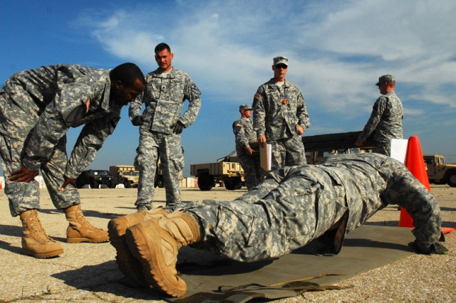 FORT HOOD, Texas-A Soldier from 2nd Special Troops Battalion, 2nd Brigade Combat Team, 1st Cavalry Division, completes his portion of 125 pushups his team was required to do as part of a strongman competition on Fort Hood, Texas, April 21.
