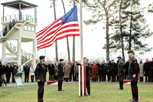 V Corps Soldiers perform a retreat ceremony of the U.S. flag during a commemoration March 31 marking the 20-year celebration of the last border patrol between East and West Germany at Point Alpha.