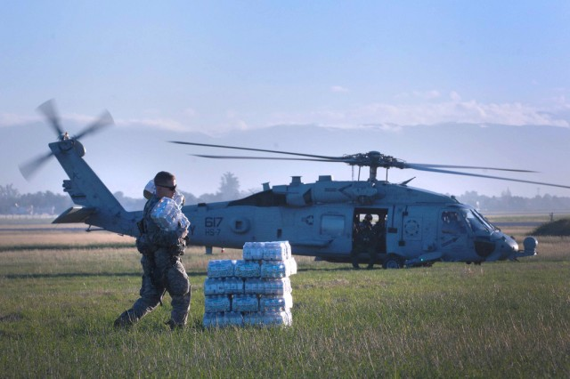 WATER FOR HAITI  A Soldier takes crates of water off a helicopter to deliver to citizens in Haiti. Army Logisticians delivered more than seven million bottles of water.