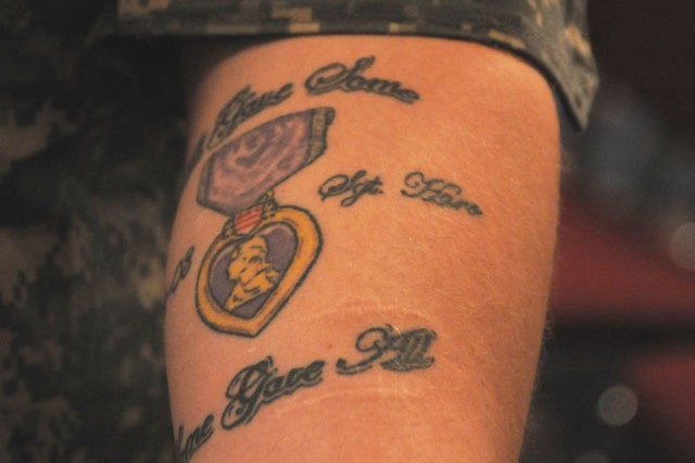 Sgt. Kyle F. Turner, a Reserve drill sergeant and cannon crewmember form Fresno, Calif., who lost his best friend in Iraq in 2003, displays his Purple Heart tattoo, honoring his fallen friend. Turner is also a Silver Star recipient.