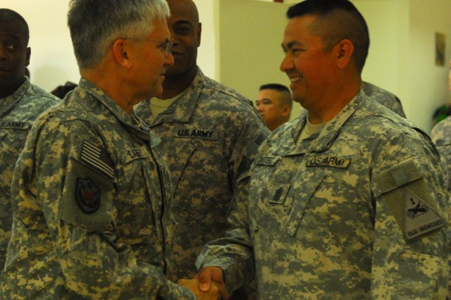 Army Chief of Staff Gen. George W. Casey, Jr. shakes hands with Command Sgt. Maj. Anthony Cortez, a Chandler, Ariz., native and command sergeant major of 2nd Battalion, 3rd Field Artillery, 1st Brigade Combat Team, 1st Armored Division, out of Fort Bliss, Texas, during a visit to Forward Operating Base Warrior, Kirkuk, Iraq, where he honored Soldiers from the brigade for their hard work, April 27.