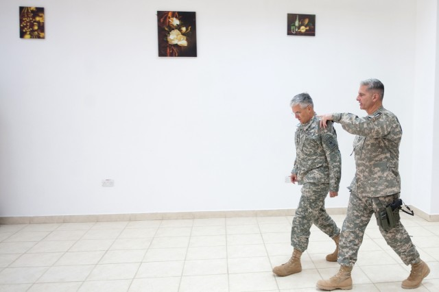 Commanding General of 3rd Infantry Division Maj. Gen. Tony Cucolo, and Chief of Staff of the Arm, Gen. George W. Casey Jr. walk from a meeting at Forward Operating Base Warrior, Kirkuk, Iraq, April 27, 2010.