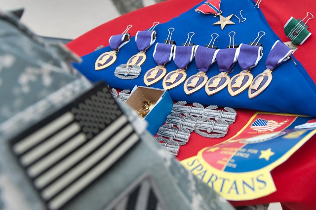 Medals and Combat badges are prepared for presentation at an award ceremony lead by Gen. George W. Casey Jr., Chief of Staff of the Army, at Forward Operating Base Marez in Mosul, Iraq, April 27, 2010.