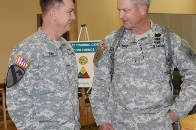 Combined Arms Center-TrainingAca,!a,,cs COL(P) Paul E. Funk II (left) talks with BG Richard Longo, Director of Training, Headquarters, Department of the Army G3.