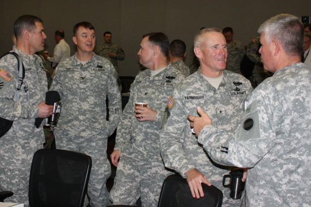 Discussing training issues between presentations (from left): BG Steven Salazar from Joint Multinational Training Command; COL(P) Paul E. Funk II, Combined Arms Center-Training; COL John Spiszer, Joint Multinational Readiness Center; BG James Yarbrough, Joint Readiness Training Center; and MG Mark Graham, U.S. Army Forces Command (FORSCOM) G3.