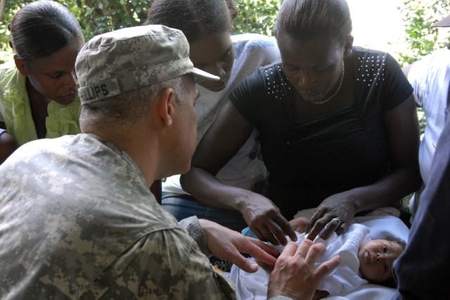 Doctor checks infant at Haiti MEDRETE