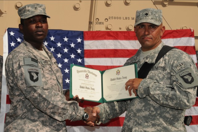 KANDAHAR AIRFIELD, Afghanistan - Spc. Jorge Moreno, power generation equipment repairer reenlisted for six years as an initial reenlistee. Moreno has been in the Army for two years.