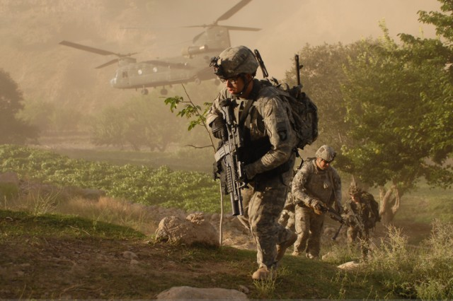 In this file photo, Soldiers from Company A, 101st Division Special Troop Battalion, air assault into a village inside Jowlzak valley, Parwan province, Afghanistan. In the coming year, more than 20,000 Soldiers from the division will deploy to Afghanistan, the first time an entire Army division has deployed to Operation Enduring Freedom within one year.