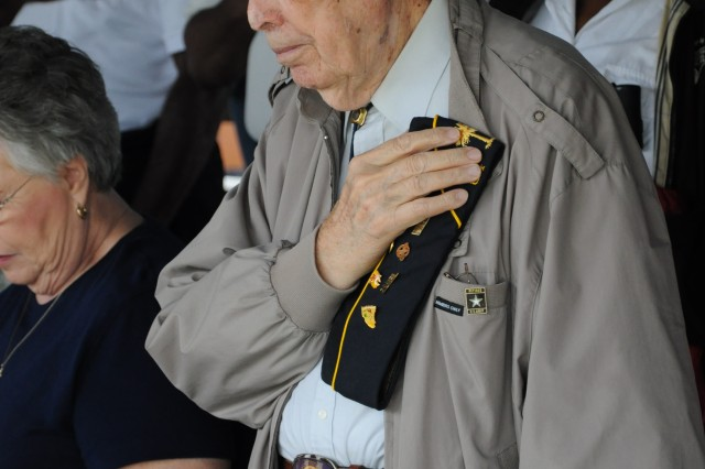 Leland Lewis, a World War IIAca,!E+veteran from Hemingway, bows his head in prayer during the Retiree Recognition Ceremony Saturday at Darby Field. More than 1,500 retiree attended this year's Retiree Appreciation Days.