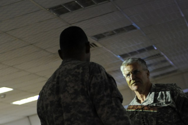 Chief of Staff of the Army Gen. George W. Casey Jr. talks with Soldiers of the 1st Infantry Division at Basrah, Iraq, Apr. 28, 2010.
