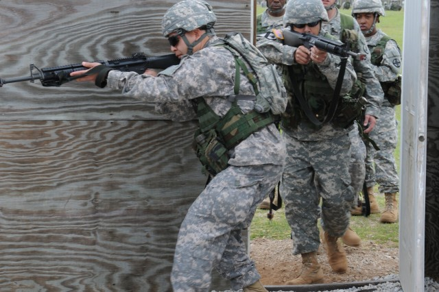 Warrant officer candidates conduct Soldier tasks at Tactical Training Base Freedom at Fort Rucker April 27. CH-47 Chinook pilots performed a joint mission with the WOCs, transporting them to the base.
