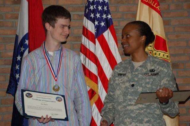 Kyle Kagele (L) chats with Lt. Col. Fern O. Sumpter during award ceremonies, April 16. Kagele was named Youth Volunteer of the Year for serving as treasurer of the AFNORTH International School Student Council and working with the AFNORTH Booster Club.