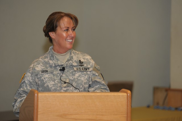 "Brig. Gen. Robin B. Akin, the 3d Sustainment Command (Expeditionary) commanding general, shares a laugh with her Soldiers during her unit's award ceremony on Thursday, April 22 at the Patton Museum.  The ceremony honored the 3d ESC for their successful deployment to Haiti in response to the Jan. 12 earthquake that devastated much of the island nation. ""It made us as Soldiers stronger, and as a team more proud.  We led our missions with our heart, as American citizens first, then as Soldiers."""