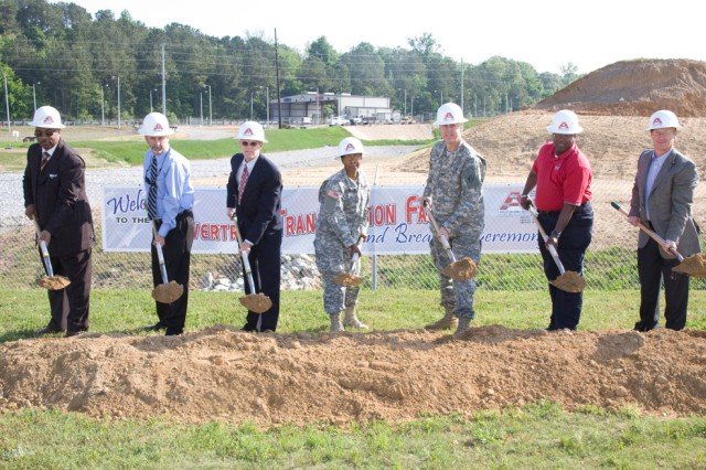 Groundbreaking participants turn the soil for the new Powertrain Transmission Facility at Anniston Army Depot.