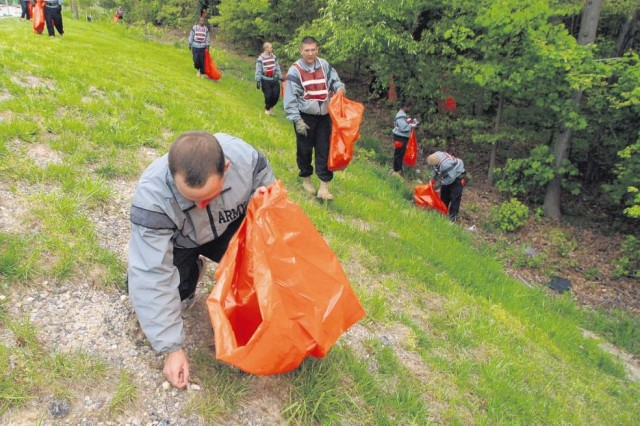 More than 100 volunteers removed trash from Route 1 Saturday. The volunteers filled 96 bags with trash and recovered discarded chairs, pallets, tires and a bed frame.