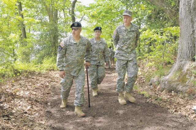 Soldiers from the Warrior Transition Unit walk along the newly opened Gunston Cove Loop Trail. The trail offers a quiet, undisturbed place for Soldiers and their families.