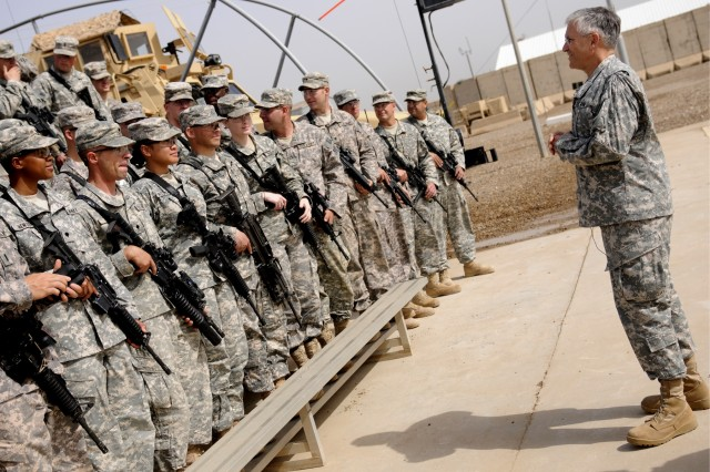 Army Chief of Staff Gen. George W. Casey Jr. talks to Soldiers of 1st Advise and Assist Brigade, 3rd Infantry Division, during his visit to COS Falcon, April 28. Casey spent some of his time with the Soldiers, asking about their experience in Iraq so far and their feelings about the progress in Iraq.