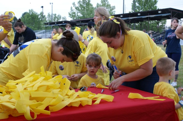 Fort Stewart Family Members write messages of love and support for Soldiers deployed in Iraq and Afghanistan during the Yellow Ribbon Walk to Iraq/Afghanistan, April 24.