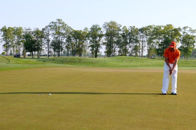 Sergeant First Class Chris Gray, 260th Quartermaster Battalion, 3rd Sustainment Bde., putts on the 8th hole at the Liberty Mutual Legends of Golf Pro-Am at the Westin Savannah Harbor, April 22. Players on the military team were from joint services and were chosen according to their golf handicaps.