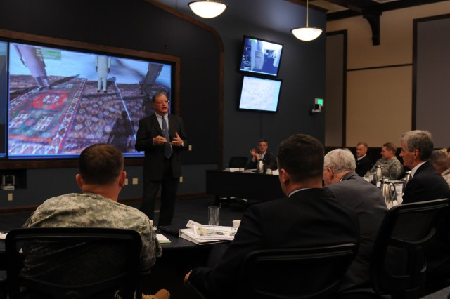 Secretary of the Army John McHugh is shown an example of  how virtual gaming technology is used to incorporate recent battlefield scenarios with lessons learned to assist in leader development and training at Fort Leavenworth, Kan., April 27, 2010.