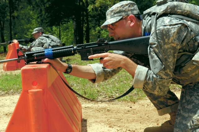 PVT Andrew Herbst advances on a target while covering his battle buddy.