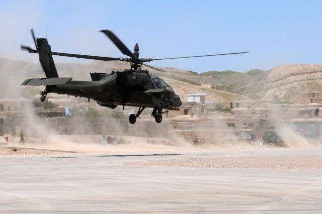 A 101st Combat Aviation Brigade, Task Force Destiny AH-64 Apache helicopter takes off from Qual-I-Nah, Afghanistan April 23, 2010 after Destiny visited the Spanish Provincial Reconstruction Team here. PHOTO BY SADIE E. BLEISTEIN www.facebook.com/101cab