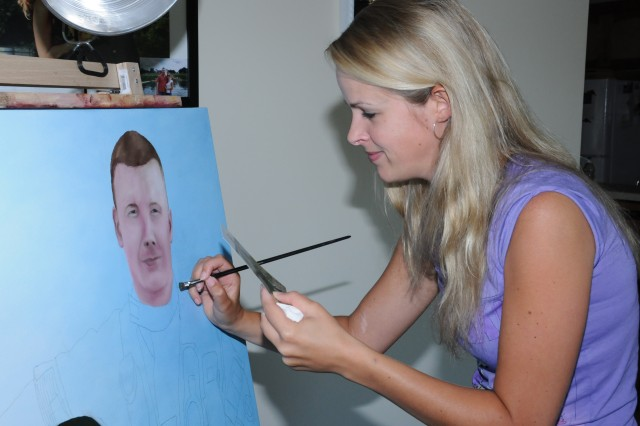 Holland native Chantal Durham-Bogers paints in her Enterprise home April 21. She moved here in September 2009 to join her American flight school student husband, 1st Lt. Benjamin Durham, and keeps busy while he's training by creating oil paintings on commission.