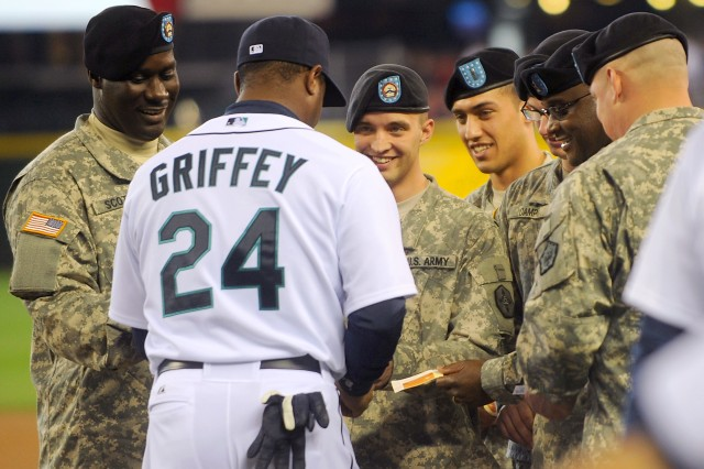 Seattle Mariners designated hitter, Ken Griffey Jr., autographs ticket stubs for Soldiers attending the Mariners Salute to the Armed Forces festivities at Safeco Field in Seattle, April 17