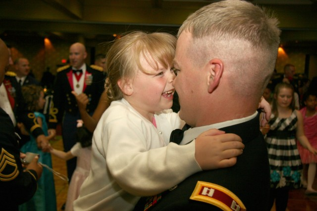 COLORADO SPRINGS, Colo.---Capt. Ron Fletcher, 749th Ordnance Company, 242nd Explosive Orndance Disposal Battalion, 71st Ordnance Group (EOD), and his daughter Ayden, 6, enjoy a special moment at the Father-Daughter Dance April 23.