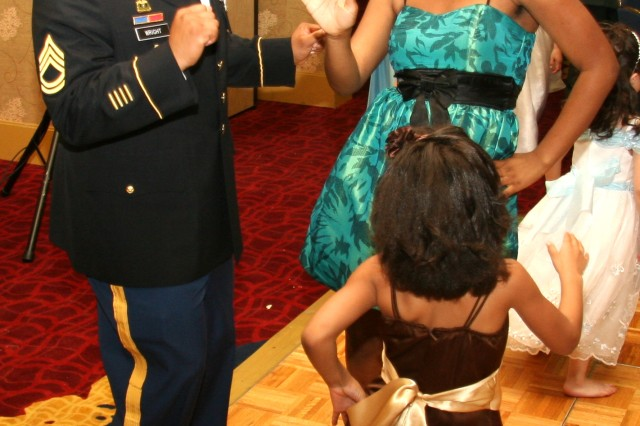 "COLORADO SPRINGS, Colo.--- Sgt. 1st Class, Gerard Wright, 2nd Battalion, 77th Field Artillery Regiment, 4th Brigade Combat Team,4th Infantry Division, dances to Beyonce's ""Single Ladies"" with daughters Ghane, 15, and Ghalisa, 7."