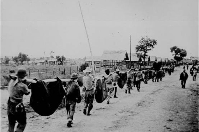 American and Filipino Soldiers march through the Philippines during the Bataan Death March of 1942.  The Soldiers, who were POWs of Japan, were forced to march 61 miles with no food or water.  Of the 75,000 Soldiers who began the march, only 54,000 made it to the final destination.