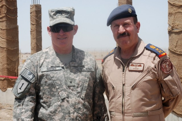 Staff Lt. Gen. Anwar, the Iraqi Air Forces Commander, and Brig. Gen. Rick Gibbs, the USD-S Deputy Commanding General for Maneuver, stand beside construction of the new Iraqi Long Range Radar and Command Center on COB Adder Apr. 27, 2010. The command center will help Iraqis manage airspace for the growing Iraqi Air Force as it acquires fixed wing and rotary wing aircraft.