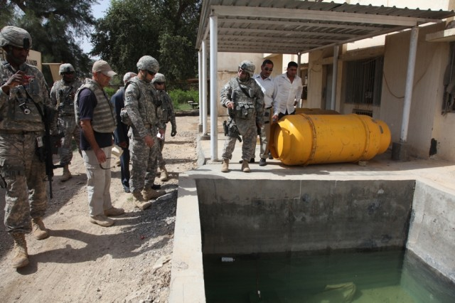 Local Iraqi leaders and Soldiers of the 1411th Civil Affairs Company from Edison, N.J., inspect a recently completed project that has improved efficiency and water quality for over 500,000 residents of Hashimyiah, Iraq.