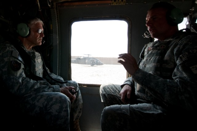 Chief of Staff of the Army Gen. George W. Casey Jr. and Brig Gen. Ben Hodges, director of operations for Regional Command - South, talk aboard a UH-60 Black Hawk helicopter in Marja, Afghanistan, April 29, 2010.
