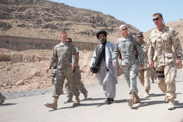 Abdul Jabar, district governor of Arghandab, Gen. George W. Casey Jr., Chief of Staff of the U.S. Army, and coalition leadership discuss security while walking in military post near Kandahar, Afghanistan, April 29, 2010.