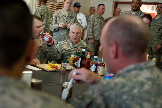 Chief of Staff of the Army, Gen. George W. Casey Jr., has lunch with Soldiers and Airmen of the Nangarhar Provincial Reconstruction Team at Forward Operating Base Finely-Shields, Afghanistan, Apr. 29, 2010.