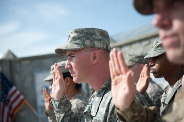 Soldiers with Task Force Mountain Warrior are re-enlisted by Chief of Staff of the Army, Gen. George W. Casey Jr., at Forward Operating Base Fenty, Afghanistan, Apr. 29, 2010.