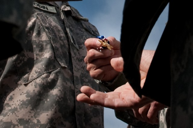 Chief of Staff of the Army, Gen. George W. Casey Jr., is handed the Silver Star award to be presented to Sgt 1st Class Goodin at Forward Operating Base Fenty, Afghanistan, Apr. 29, 2010.  The Silver Star is the nation's third highest award for heroism and valor.