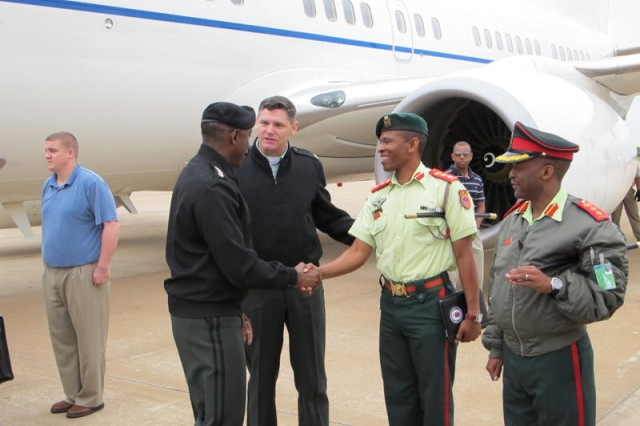 GABORONE, Botswana - Colonel M.C. Mophuting, commandant of the Botswana Defence Force (BDF) Training Establishment, and Col. Baatweng, BDF chief of protocol greet Gen. William Ward, commander of U.S. Africa Command, upon his arrival in Gaborone, Botswana, April 28, 2010. During Ward's visit, the first since December 2007, he was scheduled to meet with senior military and civilian officials to discuss ongoing and future military-to-military and security cooperation engagements. The BDF conducted 40 mil to mil exercises last year making it one of the most active of U.S. Africa Command's partner nations.