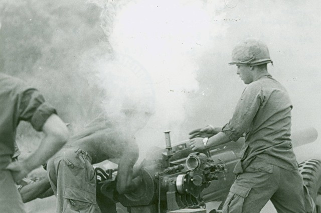 """""""In the Chamber!"""" This image shows """"A member of the 3rd Battalion, 319th Artillery Regiment, 173rd Airborne Brigade, loads another round while undergoing a fire mission in support of the 3rd BN, 503rd Infantry...."""" Vietnam. (Vietnam Misc Photograph Collection)."""