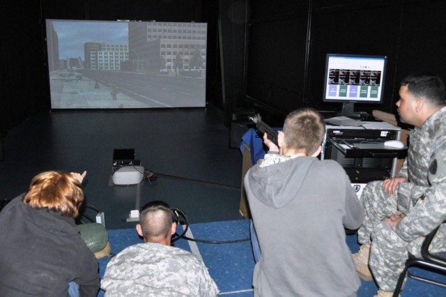 Participants in the 7th Army JMTC Open House held at USAG Schinnen April 30, 2010, test the features of the Engagement Skills Trainer 2000. The USAG Benelux and USAG Schinnen TSC possess the EST 2000.