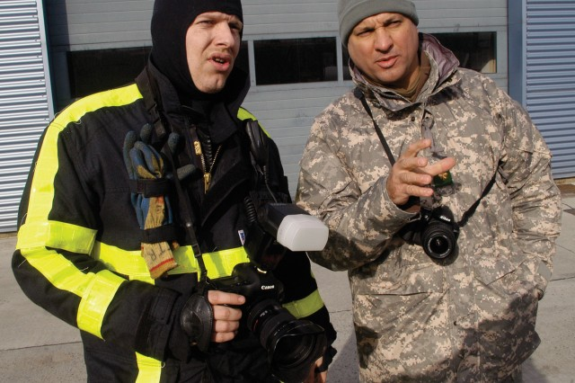 Zaventem Firefighter Cpl. Christophe Trogh and Maj. Michael A. Petrunyak, commander of the U.S. Army Europe EMAT, discuss a scenario during a combined training exercise.