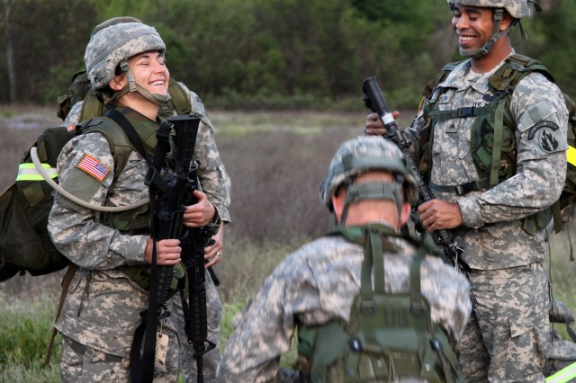 Soldiers have a laugh right before a 10K ruck march during the 63rd Regional Support Command Best Warrior competition at Fort Hunter Liggett, California.