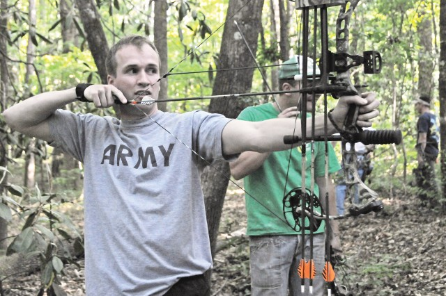Matt Morrison aims at a 3-D target while participating in a Fort Rucker Archery Club shoot April 22.
