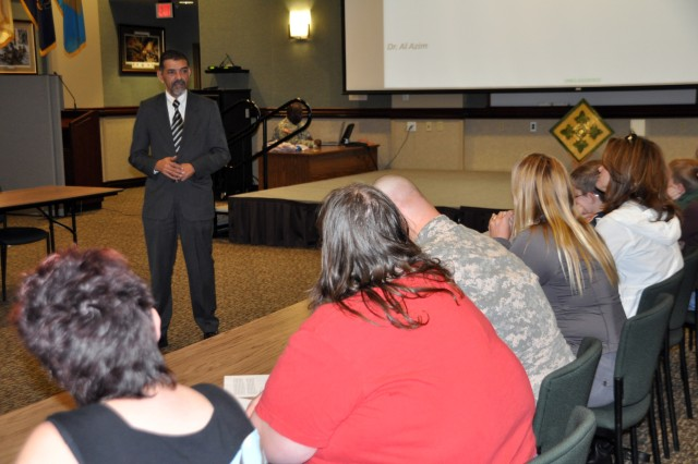 FORT CARSON, Colo.--- Alaa Abdelazim, division cultural political advisor, 4th Infantry Division, speaks to a group of deployed Soldier's spouses during a cultural awareness class held April 15.