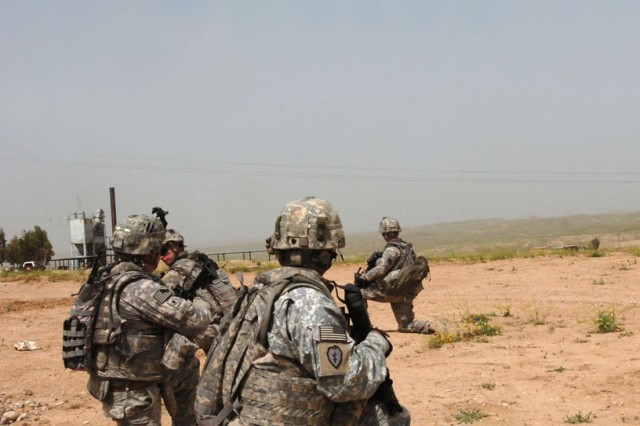 Task Force Wings' Personnel Recovery Force Soldiers await extraction from a landing zone by a Hawaii-based UH-60L Black Hawk helicopter operated and maintained by air crews of 2nd Battalion, 25th Aviation Regiment, Task Force Diamond Head, during a mission in northern Iraq, April 4.