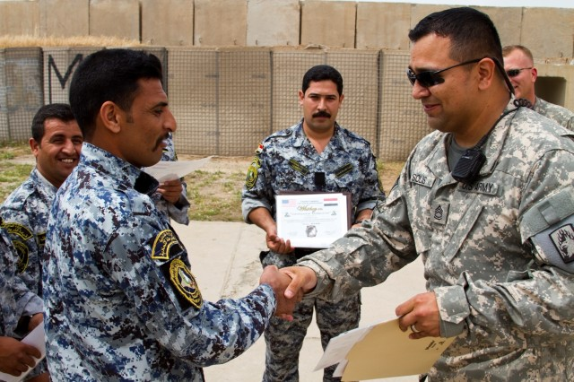 Members of the 3rd Iraqi Federal Police Division receive certificates of appreciation from Sgt. 1st Class Christopher Solis, and other members of 2nd Battalion, 159th Aviation Regiment, Task Force Gunslinger, to show their appreciation for establishing a partnership at Contingency Operating Site Diamondback in Mosul, Iraq, April 10. The partnership highlighted NCO professionalism and leadership.  (Photo by: Capt. Daniel McGurk  2nd Bn., 159th Avn. Regt.)