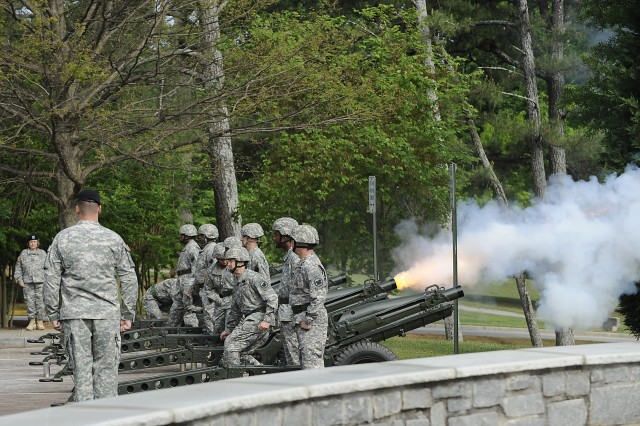 The Army Reserve salute battery fires a volley during the retirement ceremony for Sholar. Third Army volunteers recognized for service