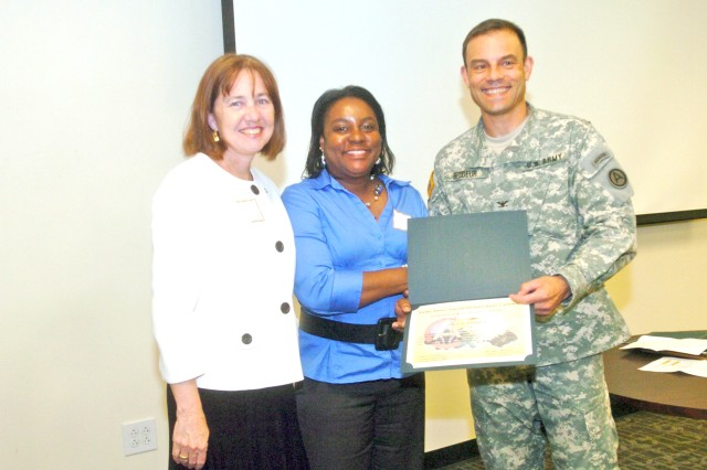 Kimberly Webster (left), wife of Third Army/U.S. Army Central (Third Army) commander, Lt. Gen. William G. Webster, and Col. Jeffrey Brodeur, Third Army deputy chief of staff, present Tanza Cooper with a certificate of appreciation during Third Army's Family Readiness Group meeting at Fort McPherson April 22. Cooper was one of 46 volunteers recognized during the meeting for her volunteer work over the past year which has been instrumental in supporting the Third Army team.